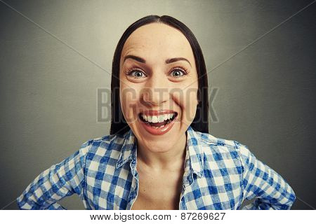 emotional portrait of laughing woman over grey background