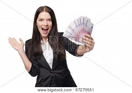 Excited woman with euro money in hand