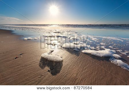 Sunshine Over North Sea Waves On Beach