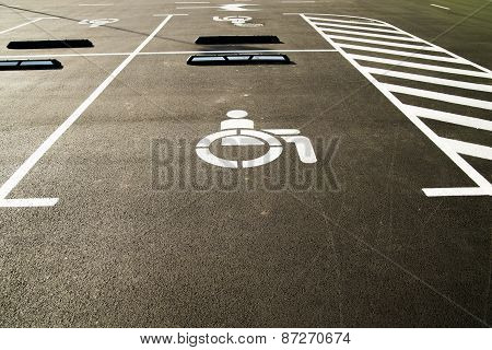 Markings On Asphalt Indicating A Parking Space For People With Limited Opportunities