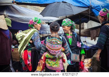 Hmong women with baby in national clothes, Vietnam