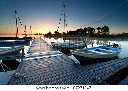 Yacht And Boat By Harbor At Sunrise