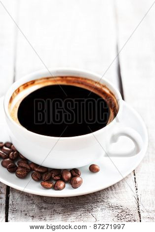 Coffee Espresso. Coffee Cup With Roasted Coffee Beans Over White Wooden Table With Copyspace.