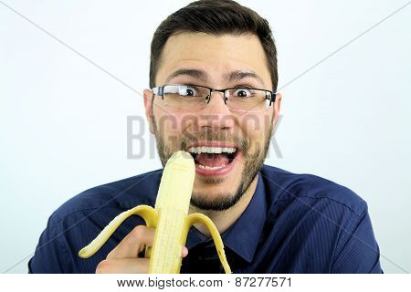 man eating a banana