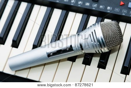 The Microphone Lies On The Synthesizer Keyboard