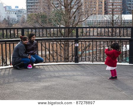 Little Girl Makes A Picture Of Parents Phone
