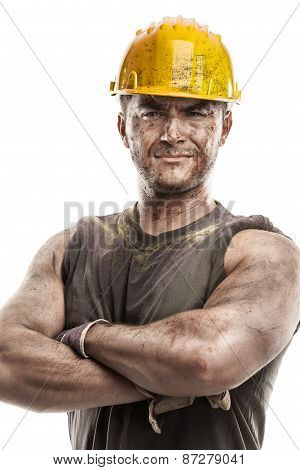 Portrait Of Dirty Worker With Helmet Crossed Arms