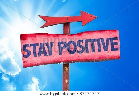 Stay Positive sign with sky background