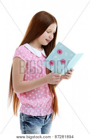 Beautiful little girl with greeting card, isolated on white