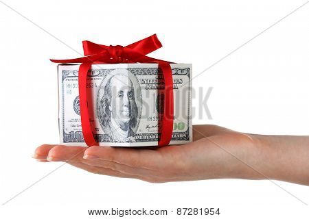 Hand holding money present box isolated on white