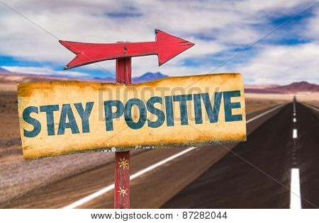 Stay Positive sign with road background