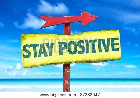 Stay Positive sign with beach background