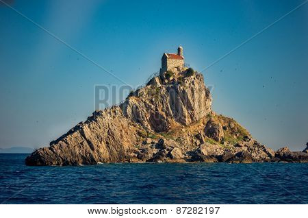 The Mali Katic island with the small church on the top is famous tourist destination and swallows nesting place, Montenegro.