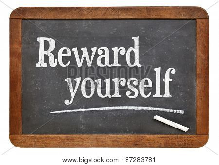 Reward yourself - motivational words on a vintage slate blackboard
