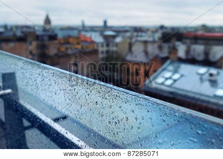 The Roofs Of The City From The Top Of A Glass Partition In The Rain
