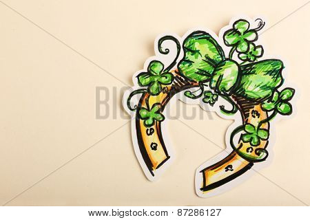 Greeting card for Saint Patrick's Day with horseshoe