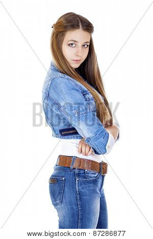 Portrait of a young girl teenager in jeans jacket and blue jeans, isolated on white background