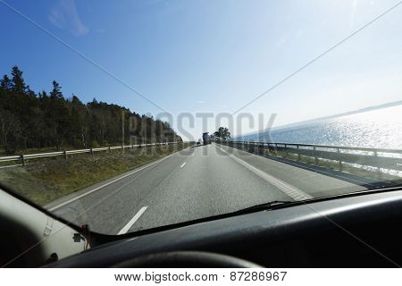 car driving a scenic highway route, seen from drivers perspective, vantage point.