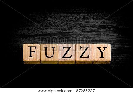 Word FUZZY Isolated On Black Background