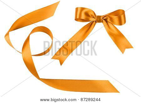 Bow And Tape From Golden Satin Fabric On A White Background