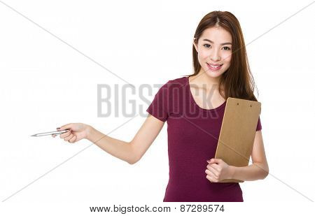 Girl with folder and pen show out