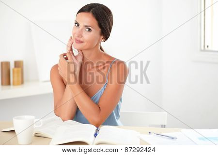 Attractive Young Woman Studying Her Books