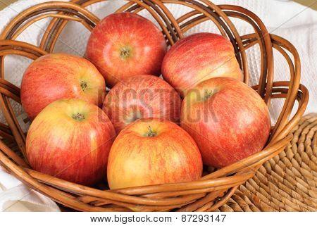 Red Gala Apples In A Wicker Plate