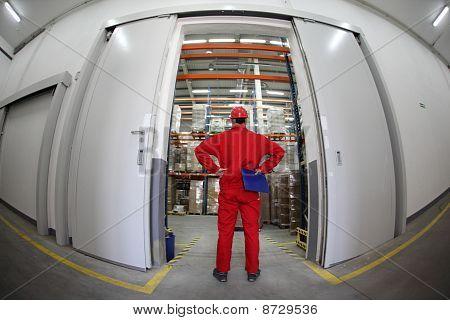 Worker standing in doorway