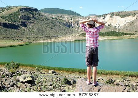 Girl Admiring The Landscape With A Lake