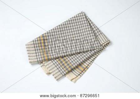 grey checkered dishtowel on white background
