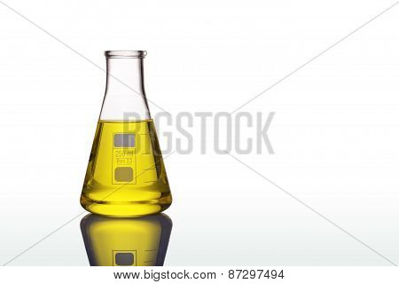 Chemical Laboratory Flask With Yellow Liquid Isolated On White