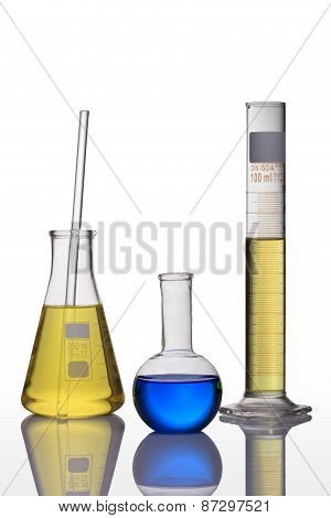 Laboratory Glassware With Blue And Yellow Liquid