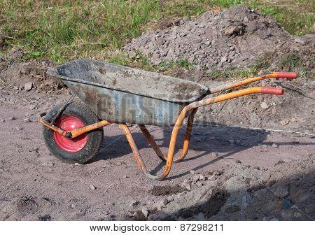 Muddy Construction Site Wheelbarrow