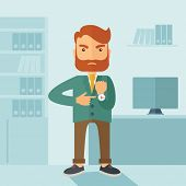 picture of angry  - A hipster Caucasian businessman with beard standing angry pointing his wristwatch inside his office - JPG