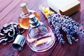foto of vapor  - lavender perfume in bottle and on a table - JPG