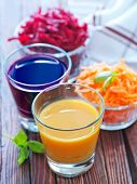 stock photo of beet  - carrot juice and beet juice in the glasses - JPG
