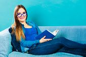 stock photo of denim wear  - Leisure education literature and home concept  - JPG