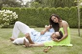 image of lap  - Full length of young man lying on woman - JPG
