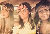 picture of hippy  - Multinational hippie girls in a van - JPG