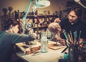 image of prosthetics  - People working in a prosthetic special fx workshop - JPG