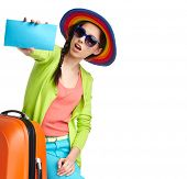 picture of boarding pass  - portrait of female tourist with travel suitcase and boarding pass - JPG
