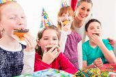 picture of birthday hat  - Children grabbing muffins at birthday party and cake - JPG