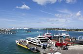 stock photo of cruise ship caribbean  - The view of ferryboat port with marina and cruise ship port in a background  - JPG