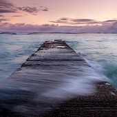 pic of waikiki  - Water washing over a breakwater on famous Waikiki beach in Honolulu Hawaii - JPG