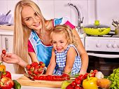 image of child feeding  - Mother  feed happy child at kitchen  - JPG