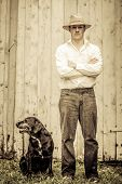 stock photo of mans-best-friend  - The Farmer and his Best Friend the Dog - JPG