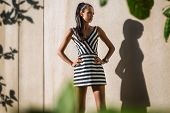 picture of striping  - Fashion model in a striped dress on a background of textured walls - JPG