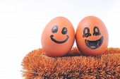 foto of envy  - envy egg face with happy couple faces eggs on white background - JPG