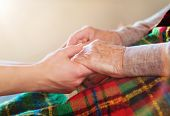 pic of granddaughter  - Unrecognizable grandmother and her granddaughter holding hands - JPG