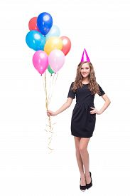 stock photo of birthday hat  - Photo of happy young woman looking at camera and isolated on white - JPG